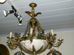 A bronze gilded and patinated lamp with cherubs and  a alabaster coupe