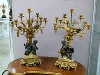 A large pair of gilded and patinated  bronze candelabra whit putto,s