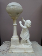 A alabaster lamp with a little girl.