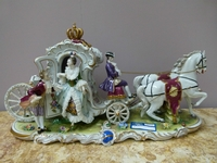 A Volkstedt porcelain carriage.
