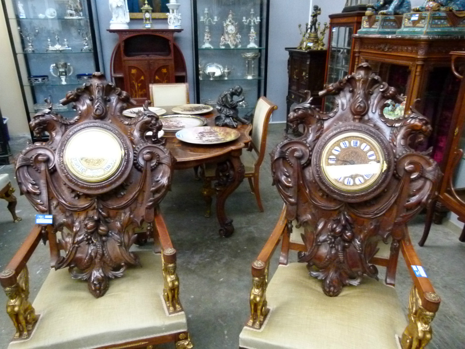 A carved wallnut clock and barometer. - Antiques from ...