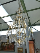 A very large bronze and crystal lamp.