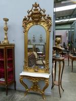 A German gilded console and mirror.