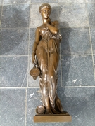 A bronze sculpture of a lady with a lamp by Dumaige H 71cm.